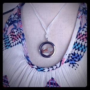 Locket pendant with seashells and crystals